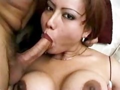 Busty shemale sucks cock